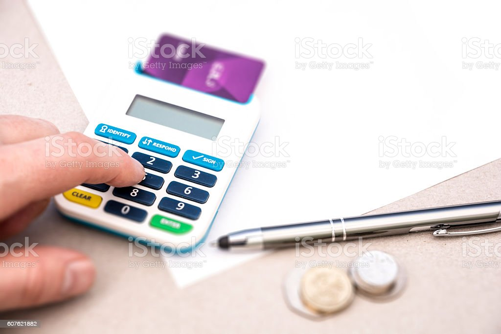 Using a Chip and Pin UK Finance Money stock photo