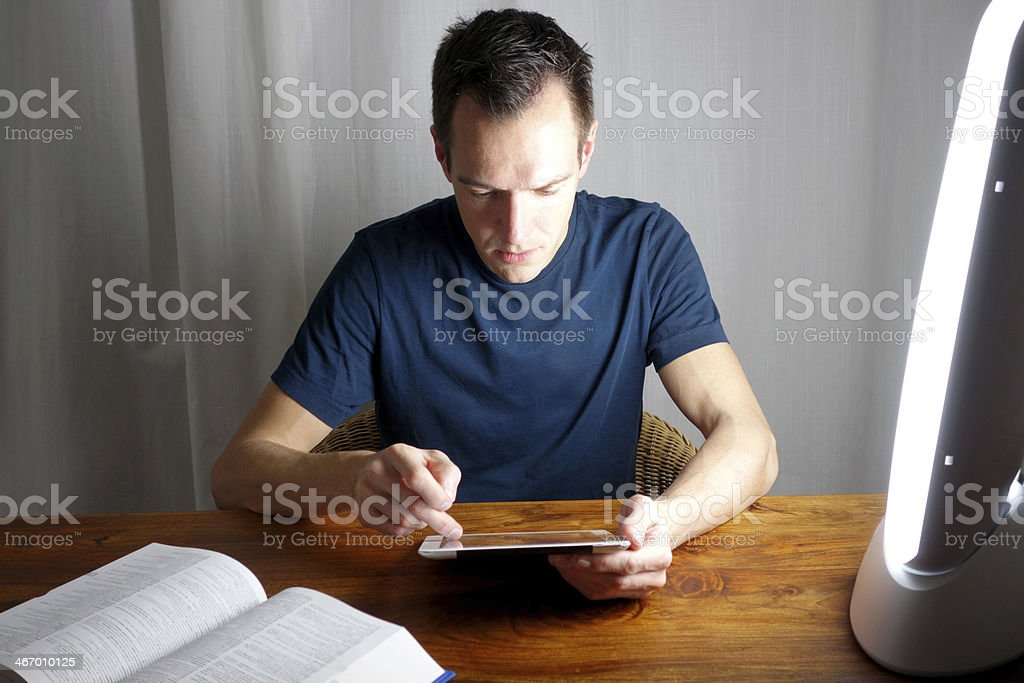 Using a daylight lamp at your desk stock photo