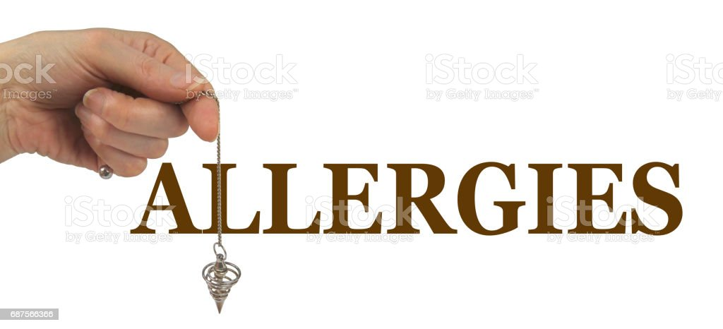 Using a Dowsing Pendulum to detect Allergies stock photo