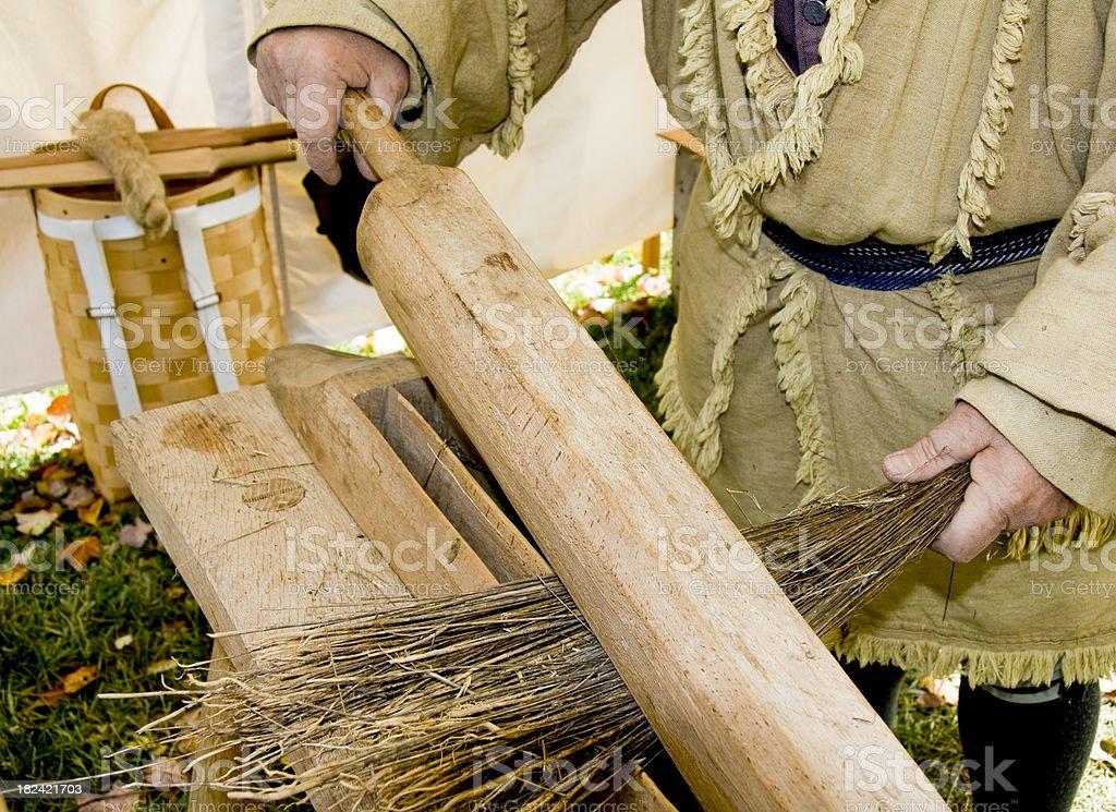 Using a Flax Break Tool stock photo