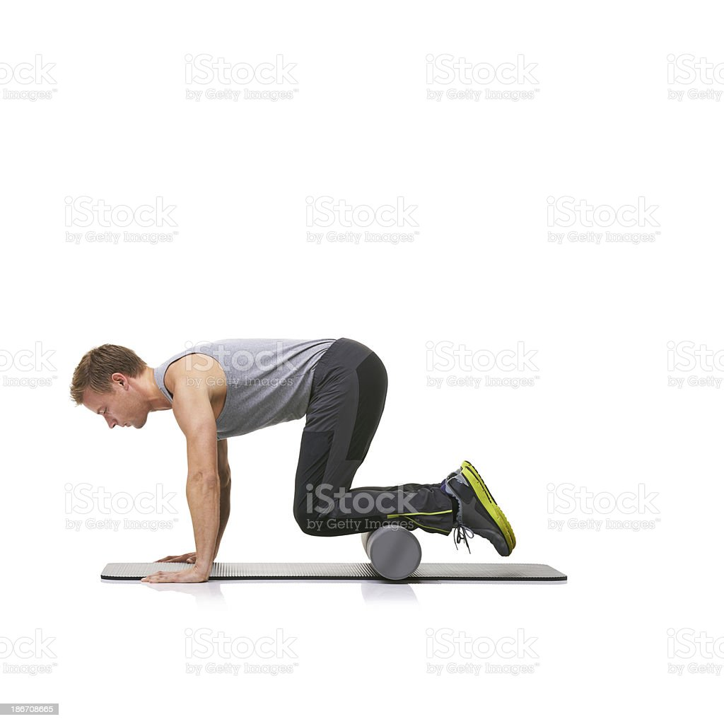Using a foam-roller to strengthen his legs royalty-free stock photo