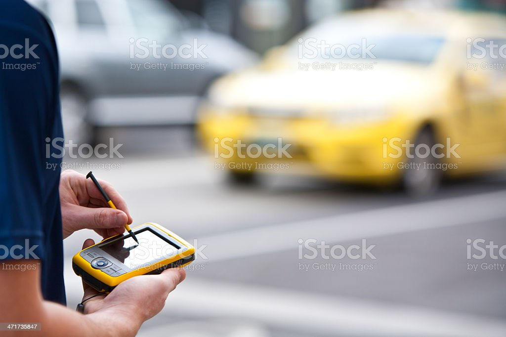 Using a Handheld GPS royalty-free stock photo