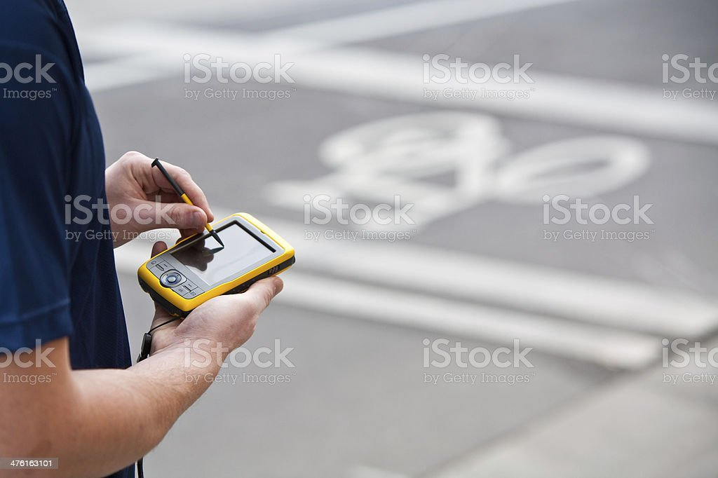 Using a Handheld GPS royalty-free stock photo