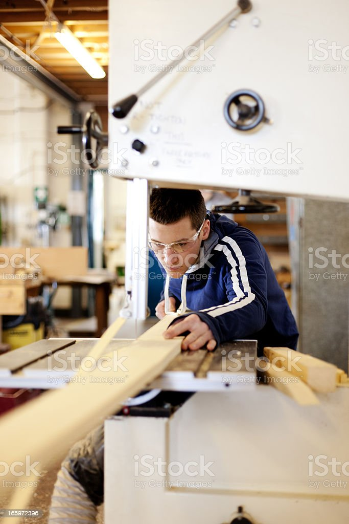 Using a jigsaw royalty-free stock photo