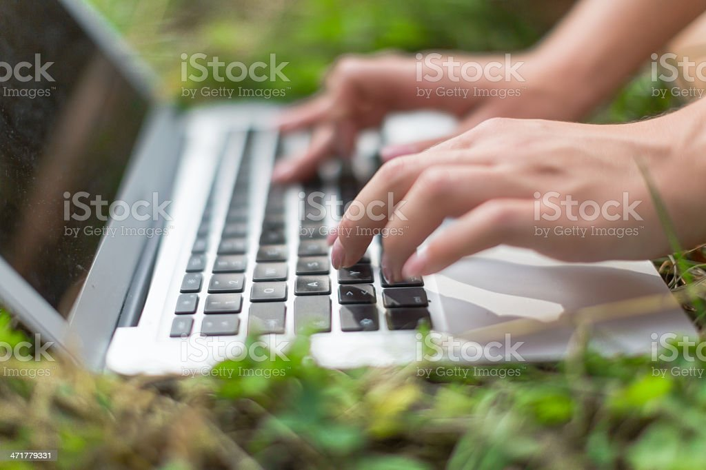 Using a laptop outside royalty-free stock photo
