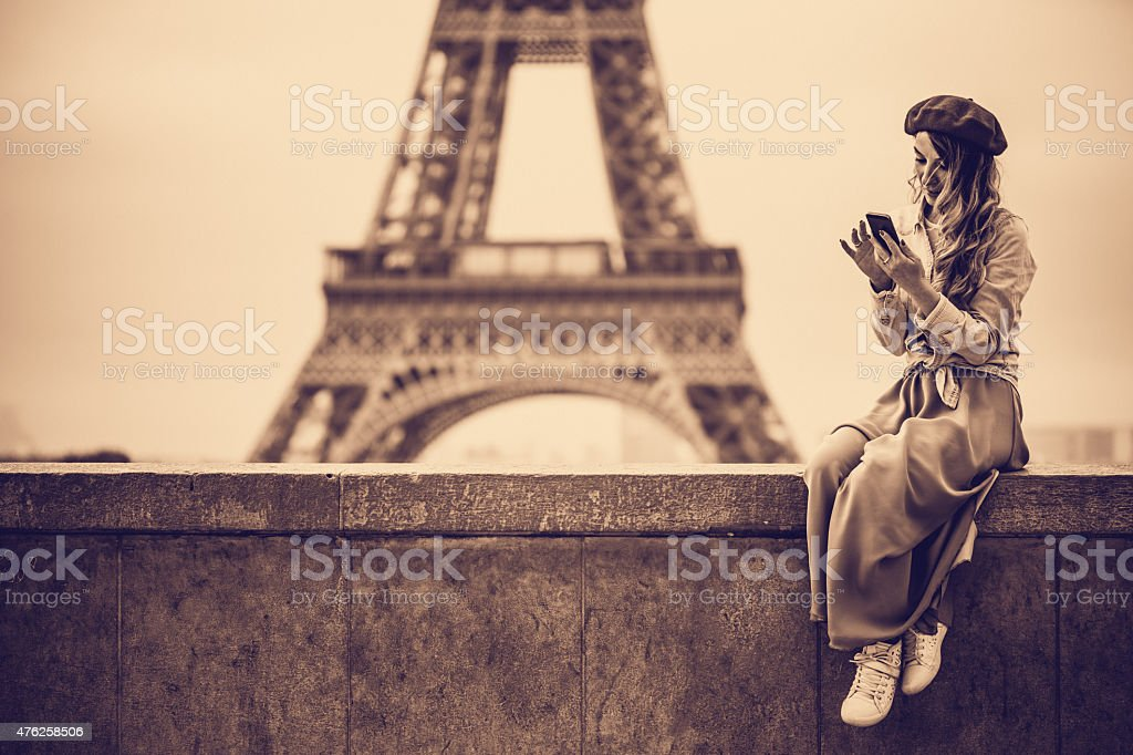 Using a mobile phone while traveling stock photo