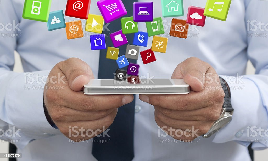 Using a mobile phone with Applications stock photo