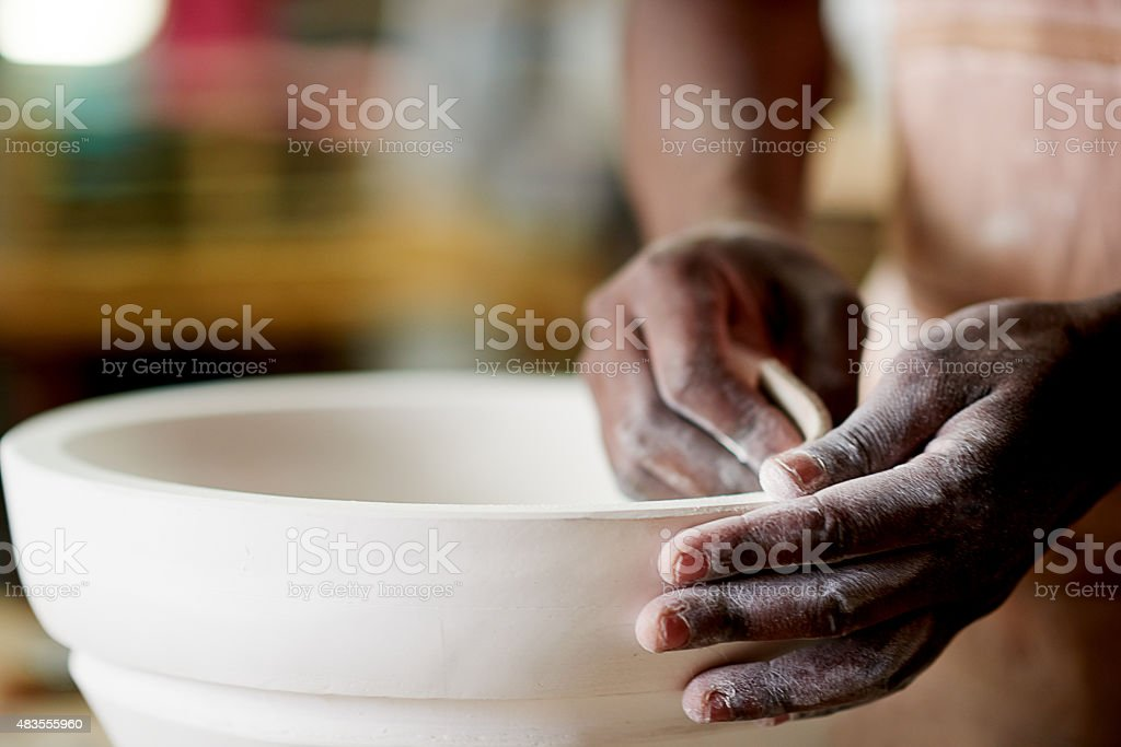Using a sanding sponge to create an even finish stock photo