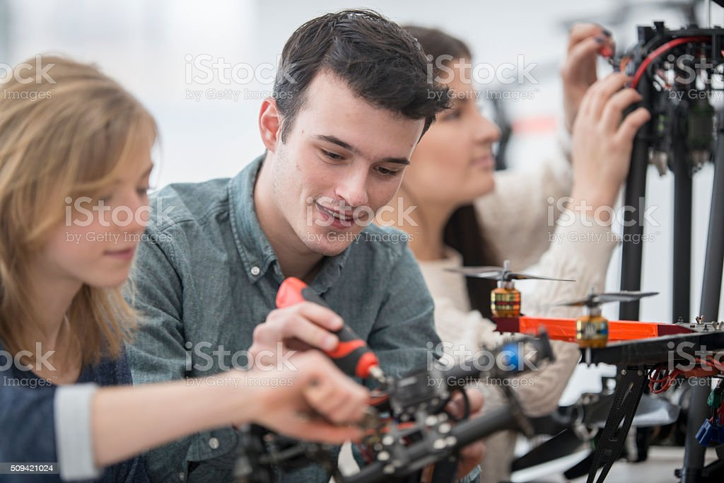 Using a Screw Driver on a Drone stock photo