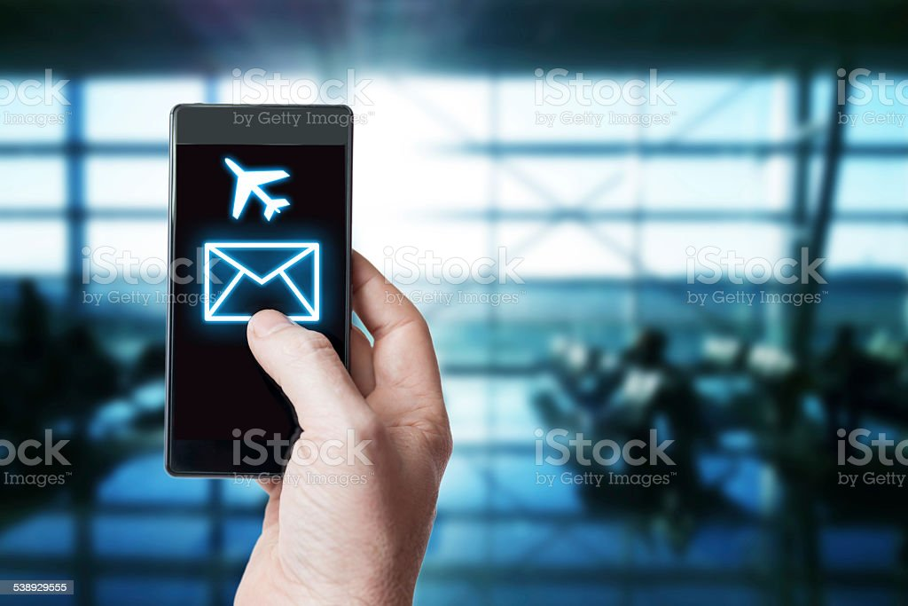 Using a smart phone in airport stock photo