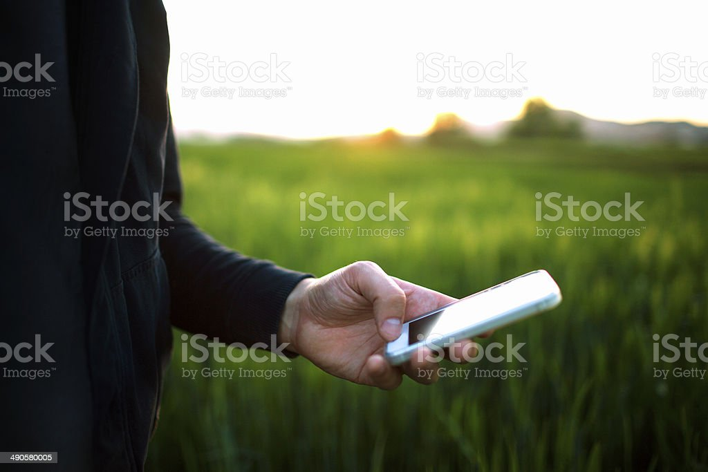 Using a smartphone outdoors stock photo