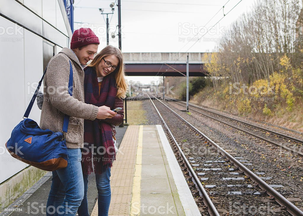 Using a Smartphone While at the Station stock photo