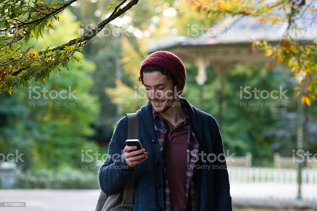 Using a smartphone whilst walking stock photo