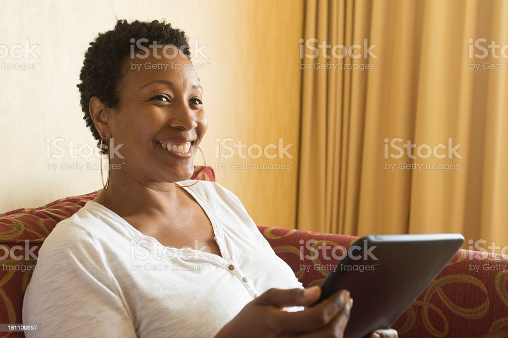 Using a Tablet Computer at Home royalty-free stock photo