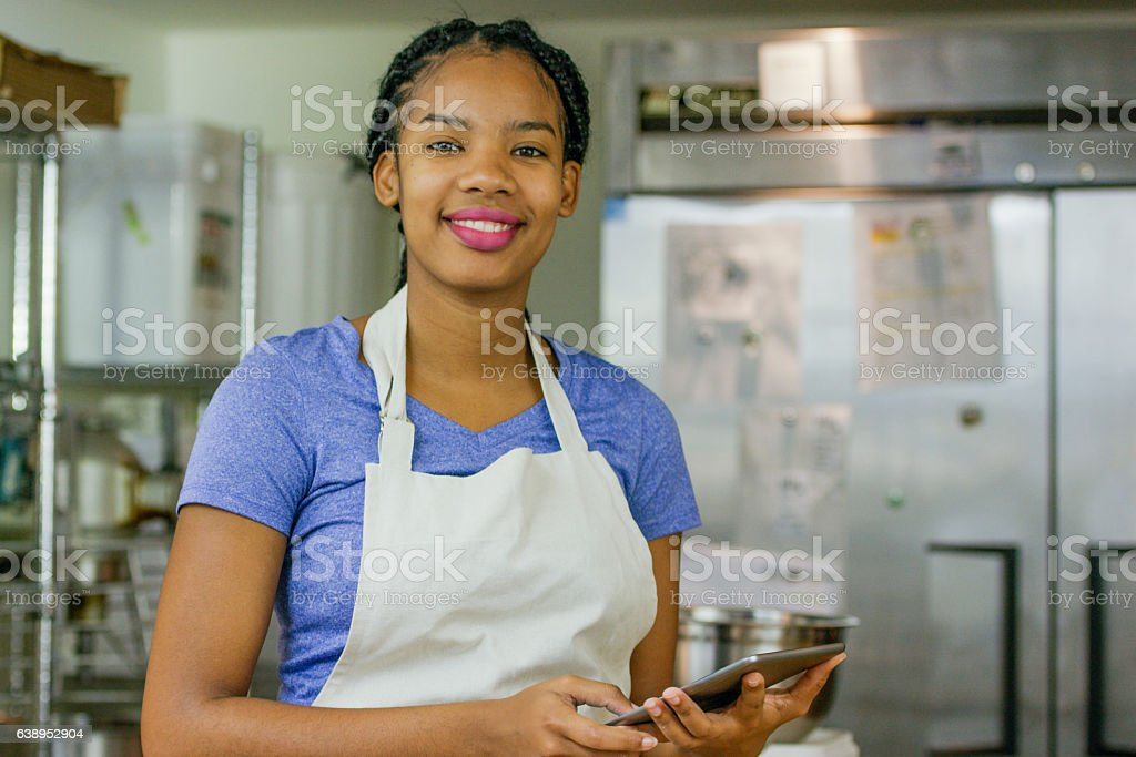 Using a Tablet in the Kitchen stock photo