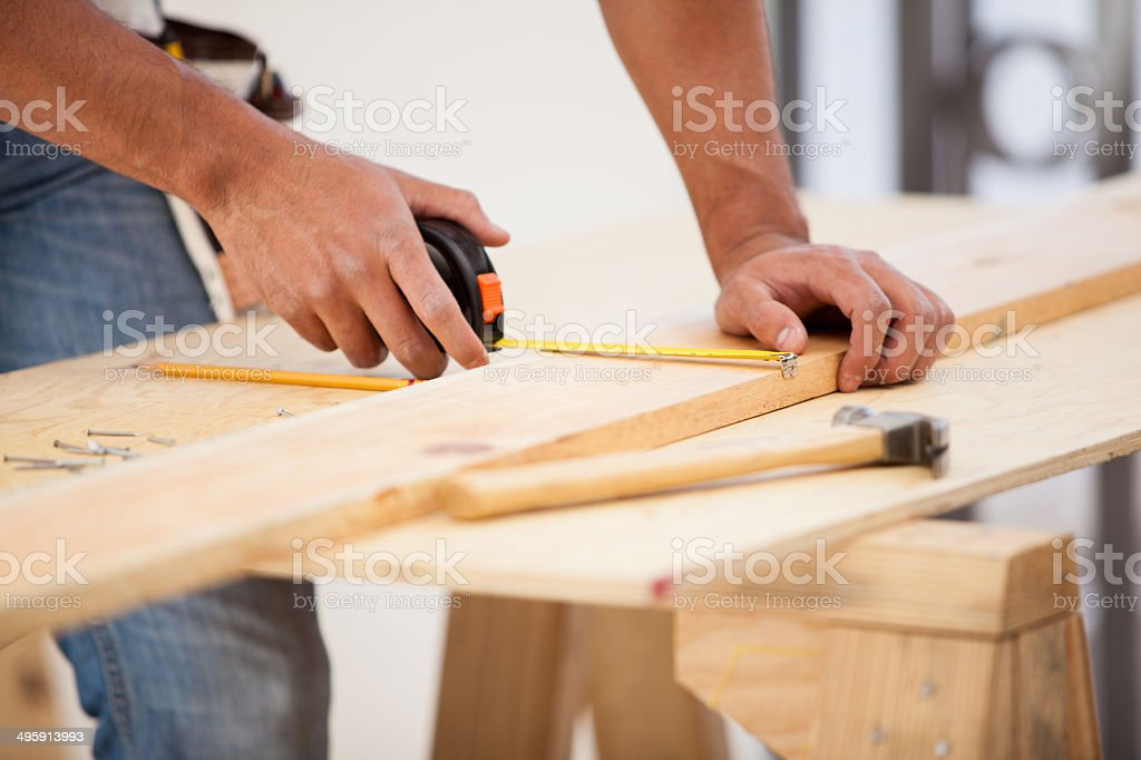 Using a tape measure stock photo