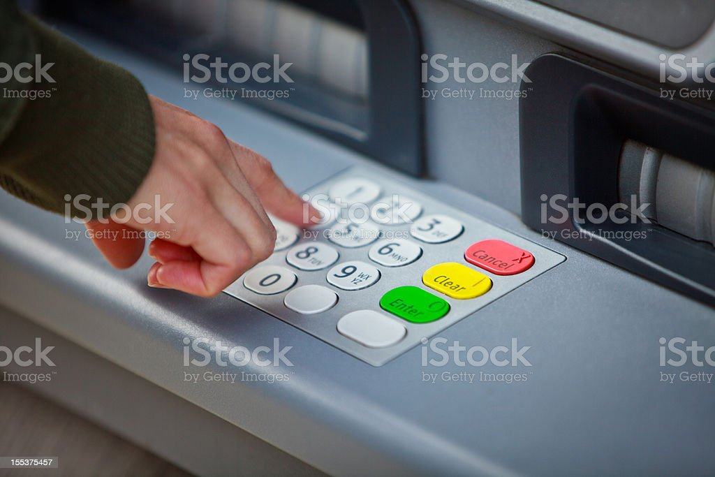 Using an Automated Teller Machine stock photo