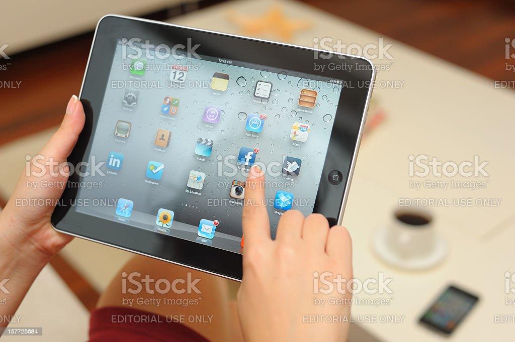 Using Apple iPad at home royalty-free stock photo