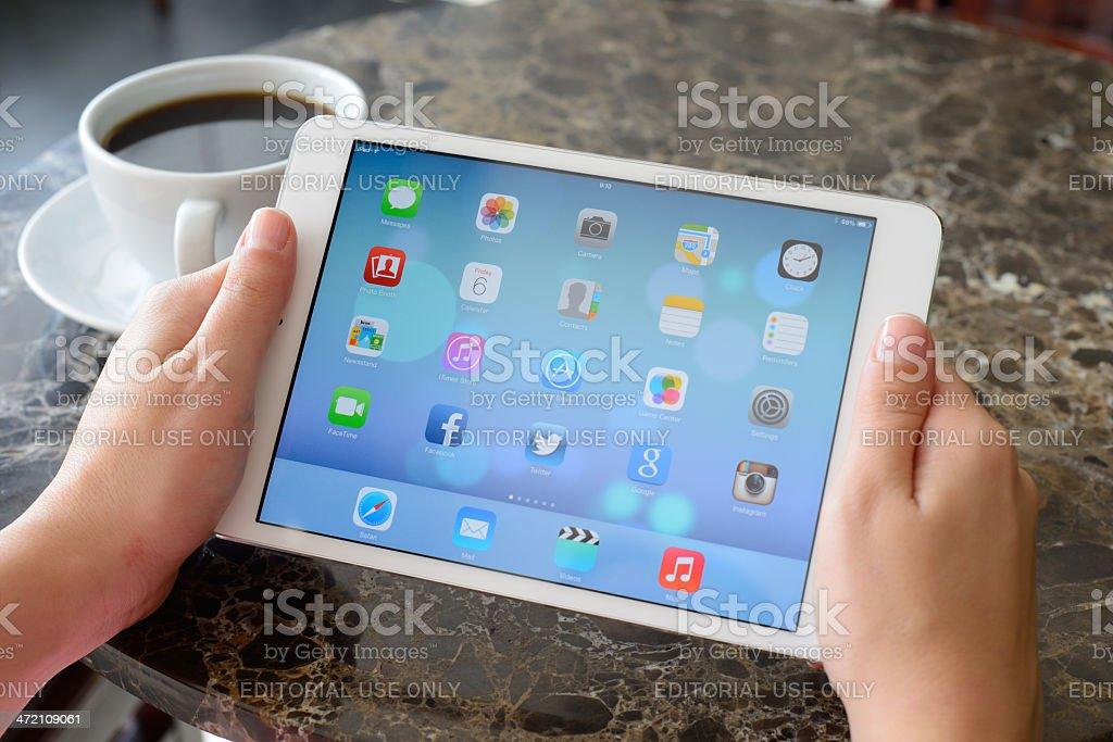 Using Apple iPad Mini stock photo