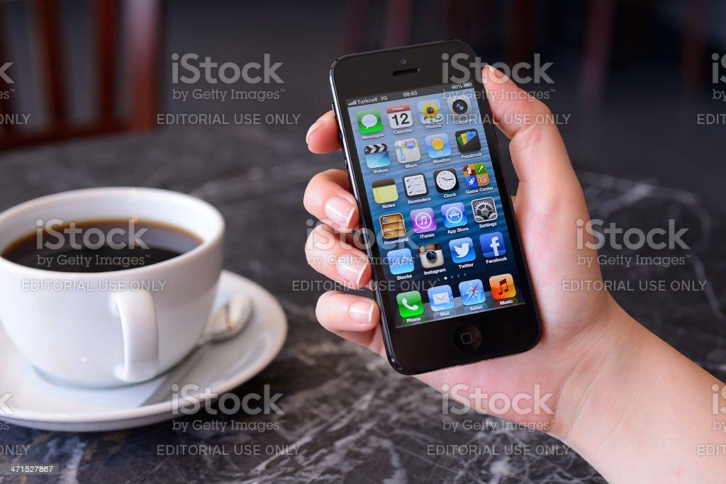 Using Apple iPhone 5 royalty-free stock photo
