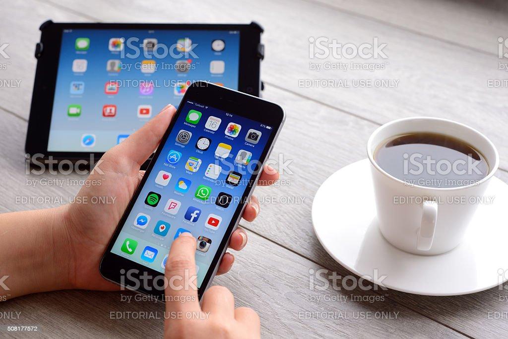 Using Apple iPhone 6 and iPad Mini stock photo