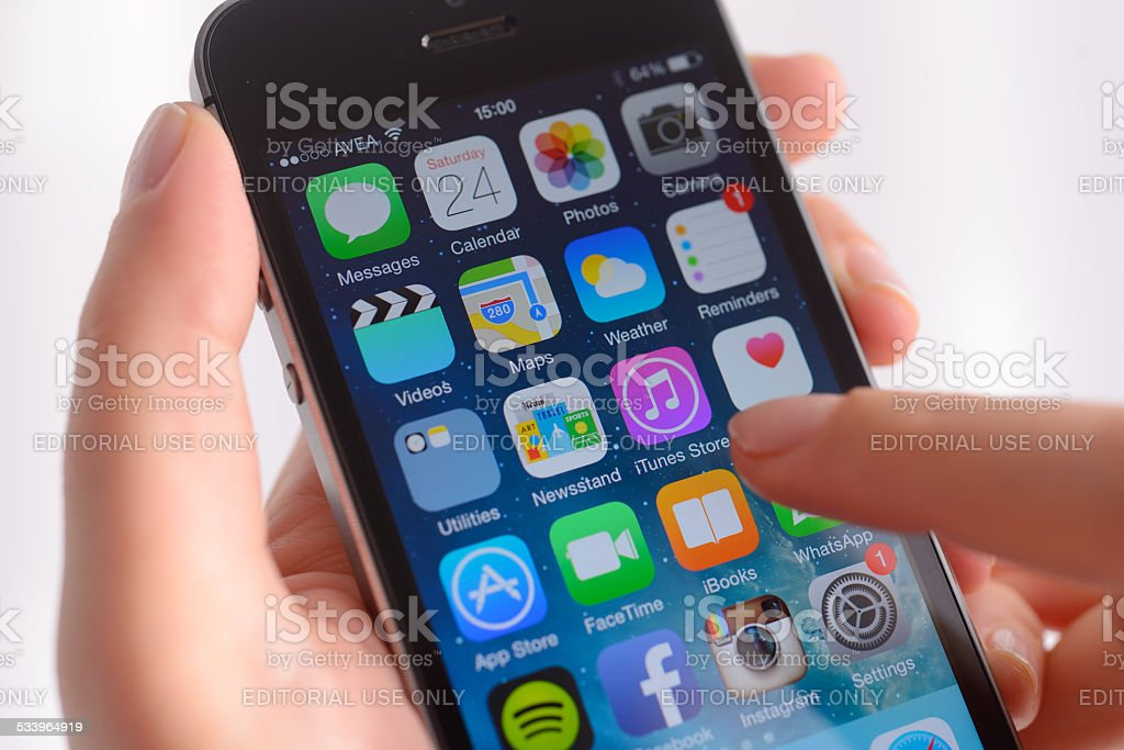 Using Apple iPhone stock photo
