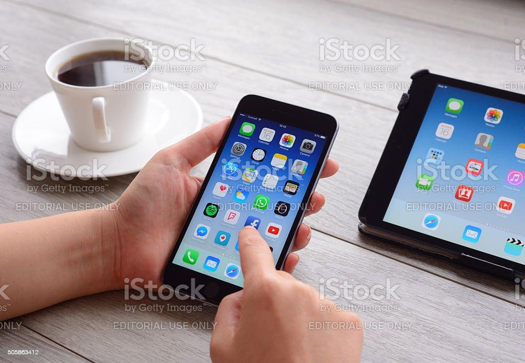 Using Apple iPhone smart phone stock photo