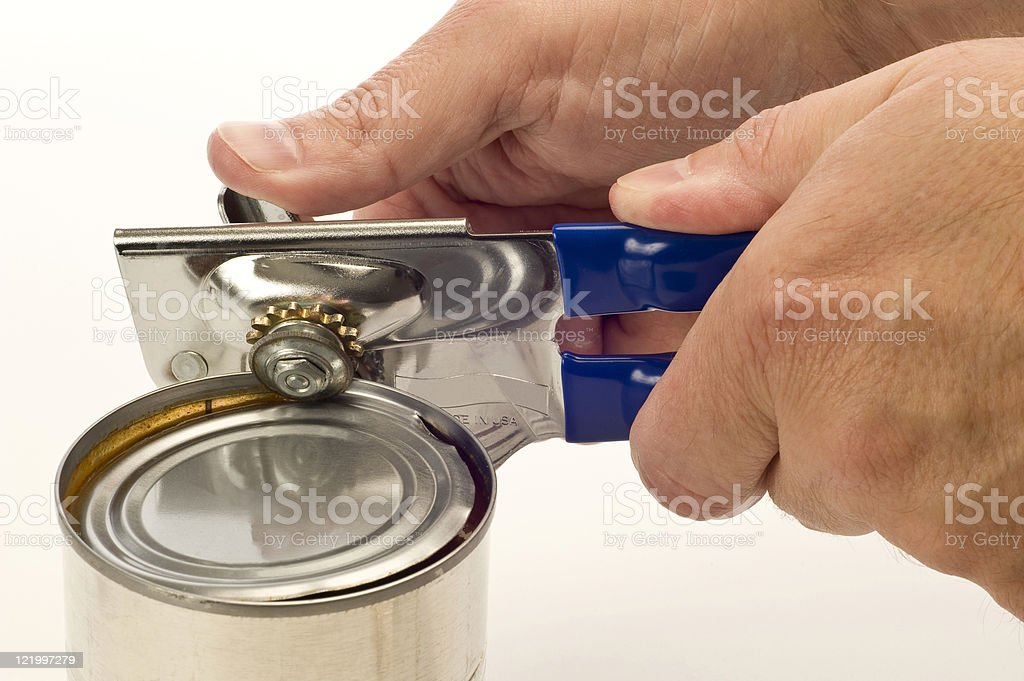Using Can Opener stock photo