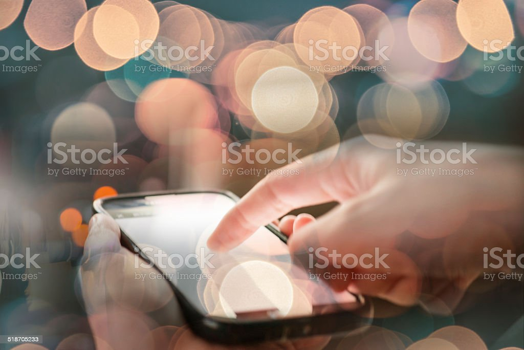 using cell phone abstract stock photo