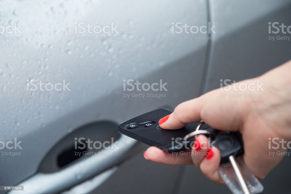 Using central locking remote to open car door. stock photo