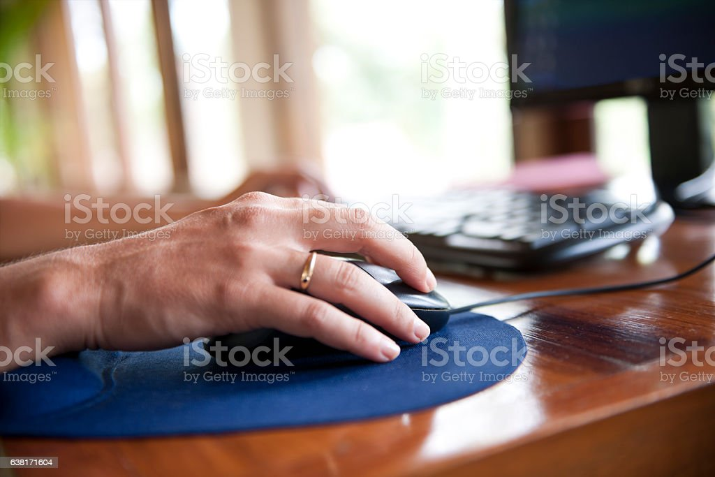 Using computer mouse stock photo