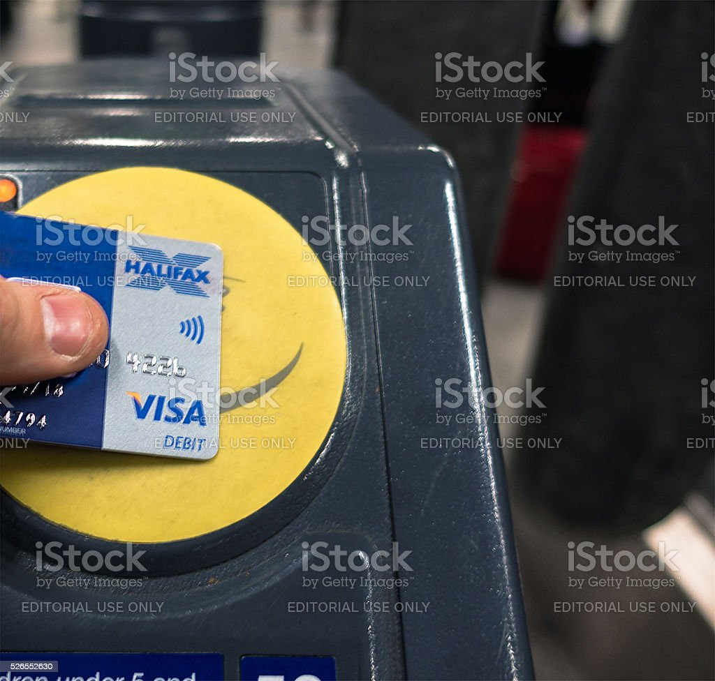 Using Contactless Visa Debit card to pay for London Underground stock photo