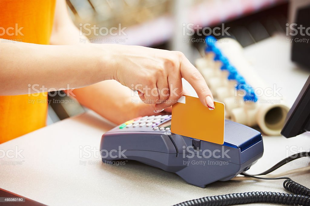 using credit card payment terminal in shop stock photo