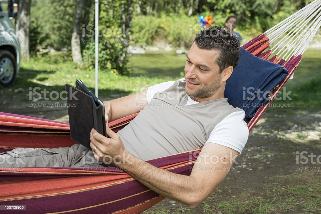 Using digital tablet in nature royalty-free stock photo