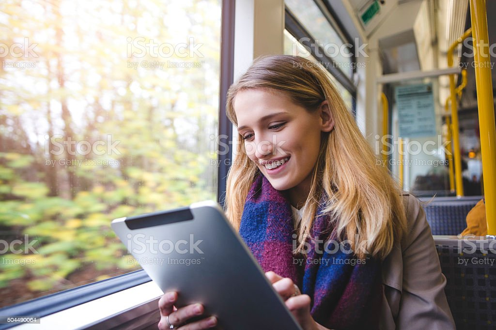 Using Digital Tablet on the Train stock photo