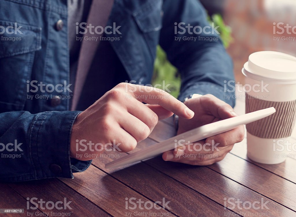 Using digital tablet stock photo