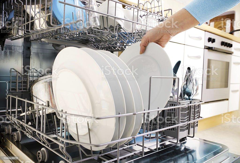 using dishwasher stock photo