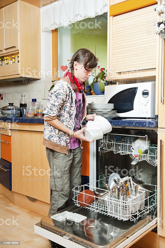 Using dishwasher royalty-free stock photo