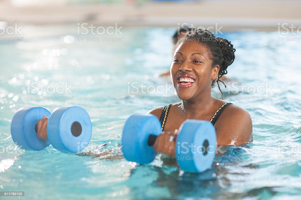Using Floating Weights in a Workout Class stock photo