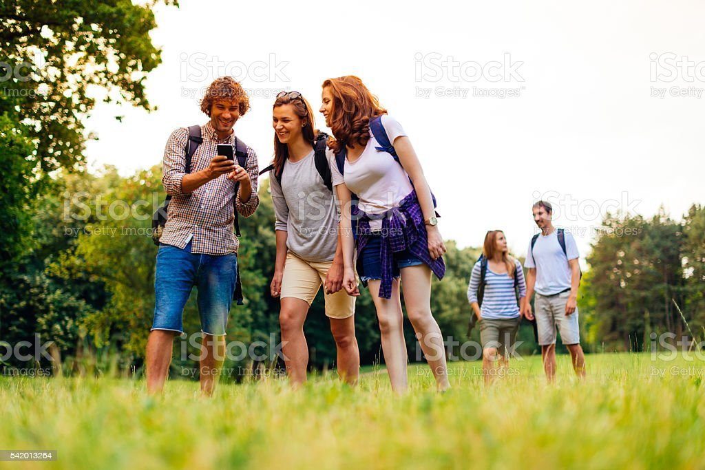 Using GPS on smart phone in exploring of nature stock photo