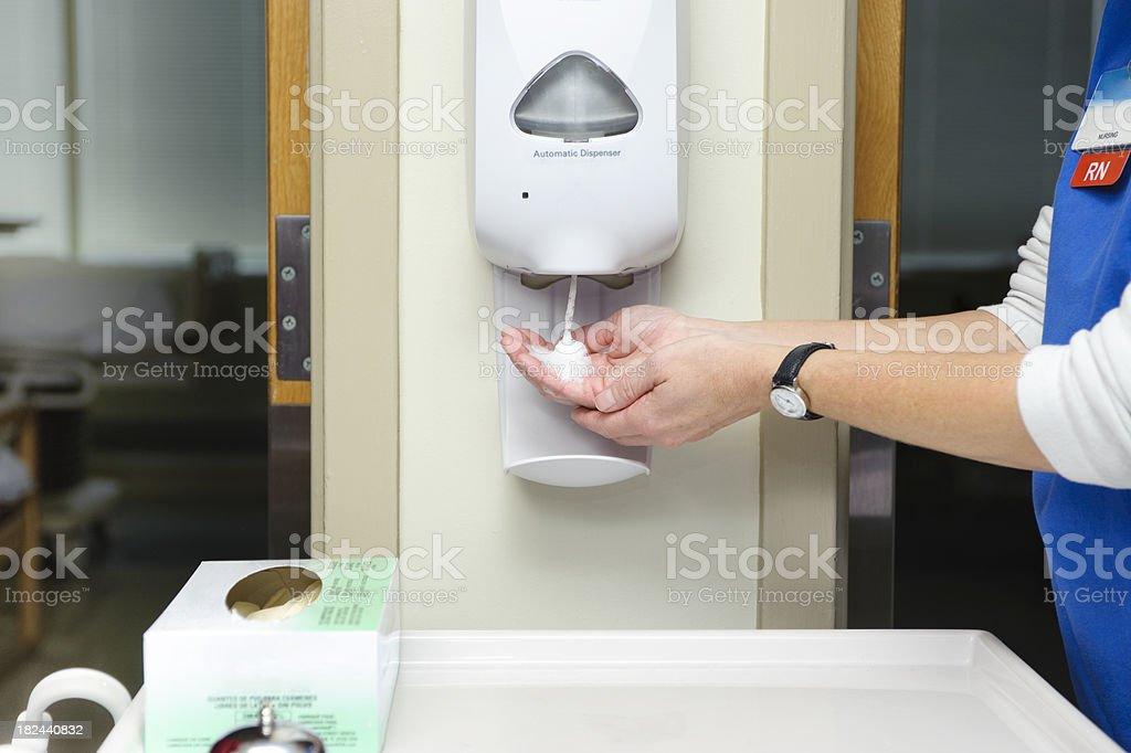 Using hand sanitizer stock photo