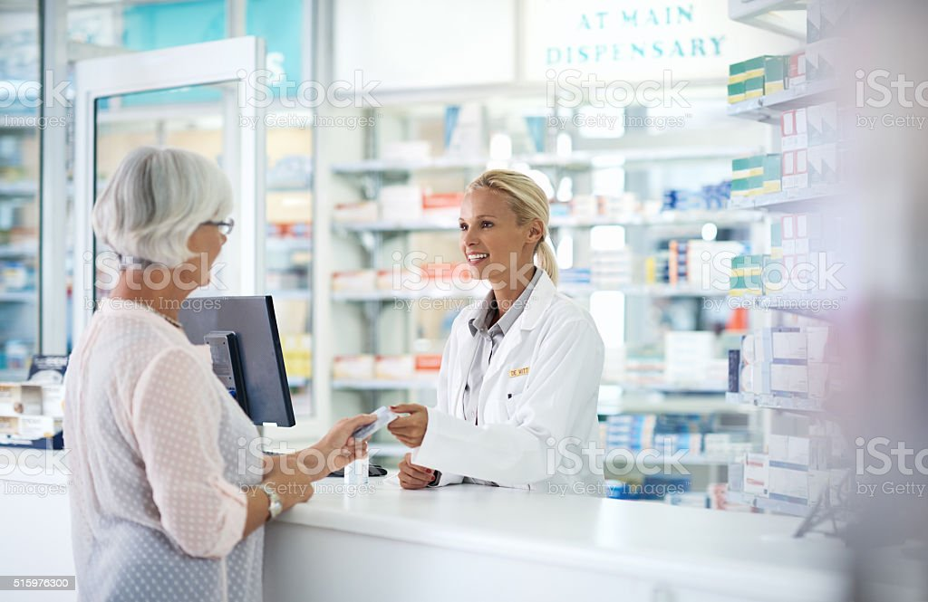 Using her senior citizen's discount for her monthly medication stock photo