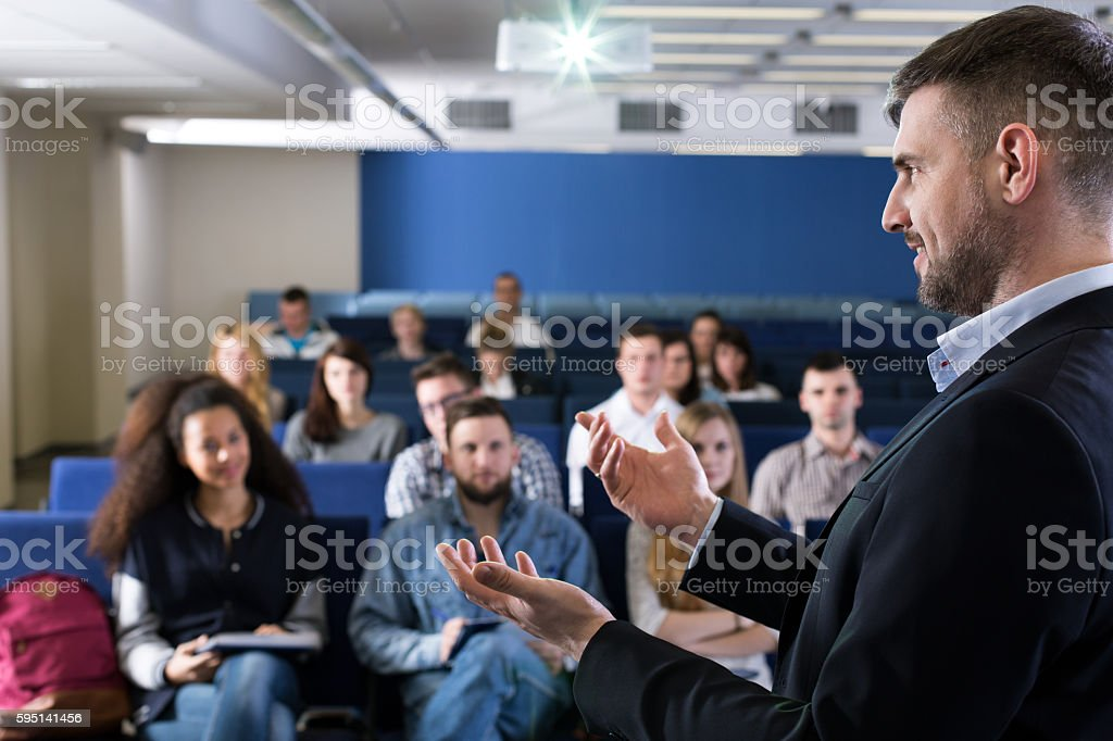 Using his body language to win attention of the listeners stock photo