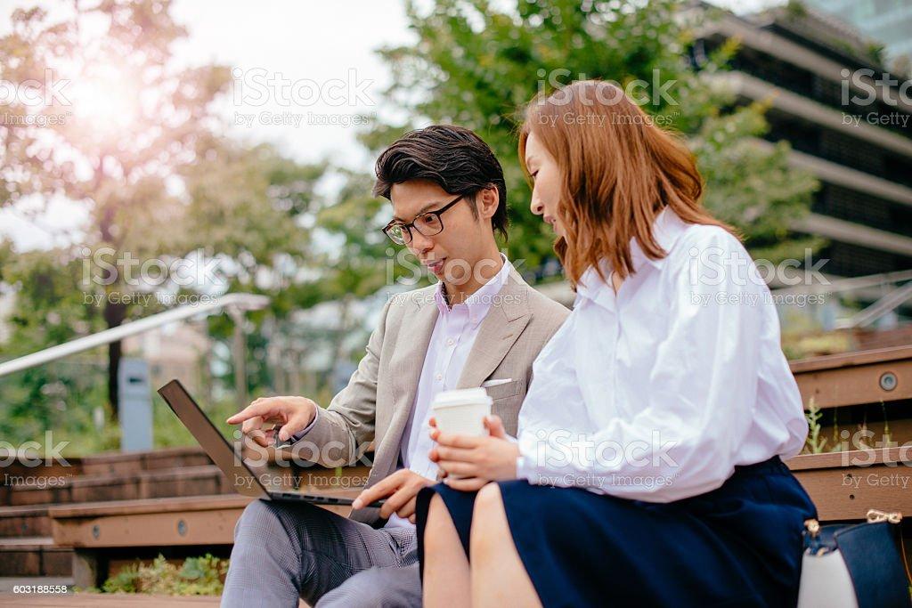 Using internet and finishing business tasks during break stock photo