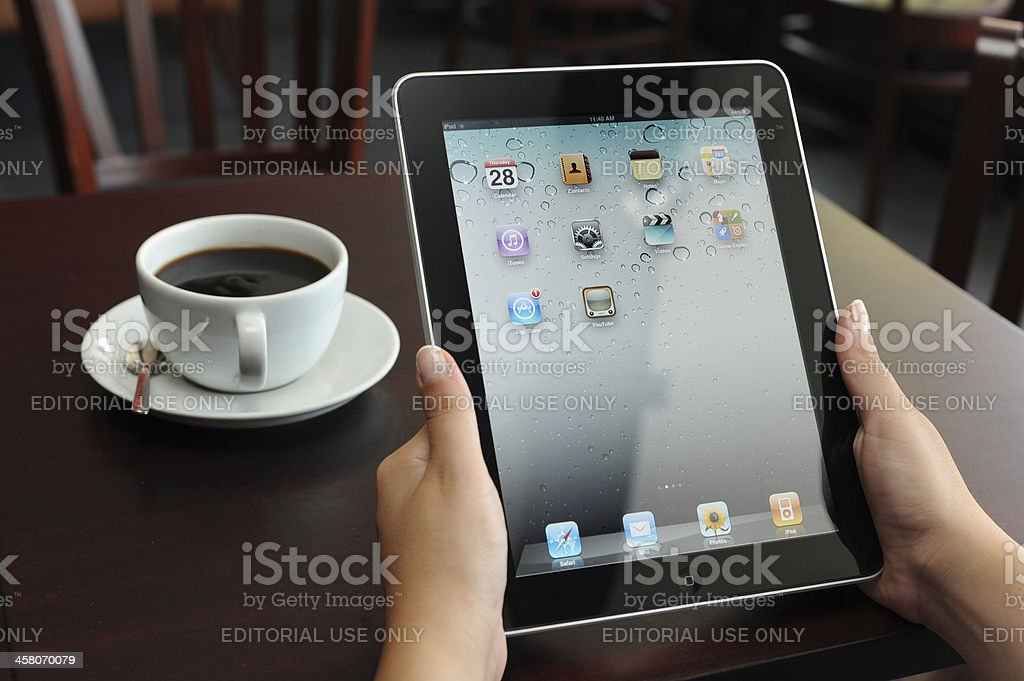 Using iPad in a Coffee Shop royalty-free stock photo