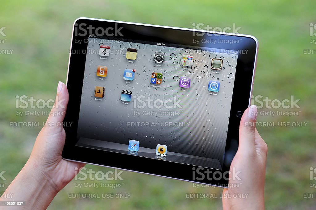 Using iPad in park royalty-free stock photo