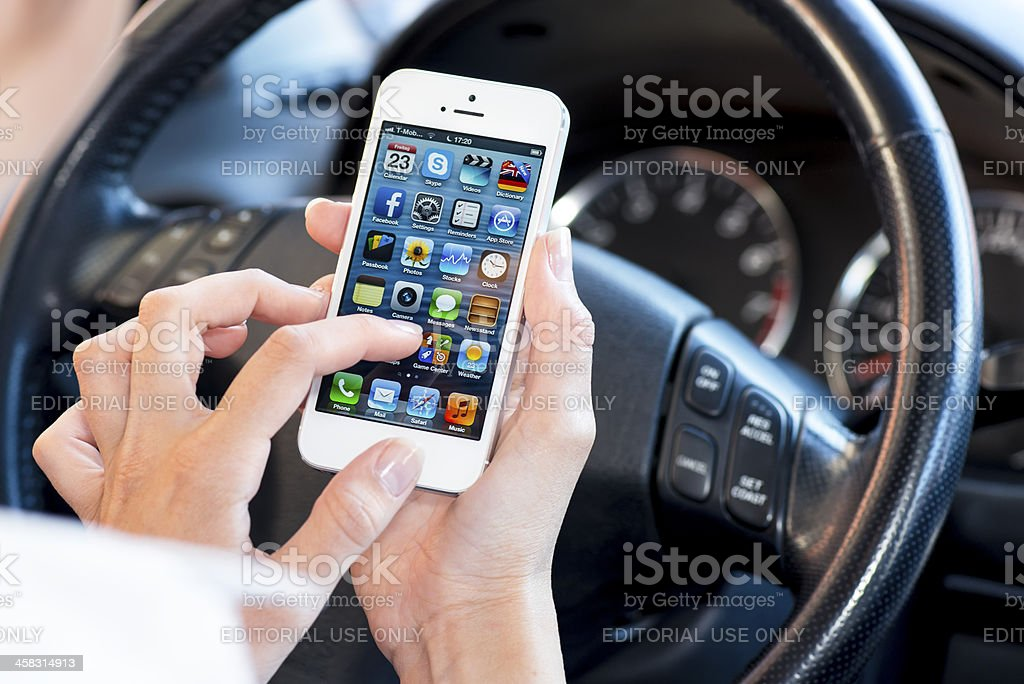 Using iPhone 5 in a car royalty-free stock photo