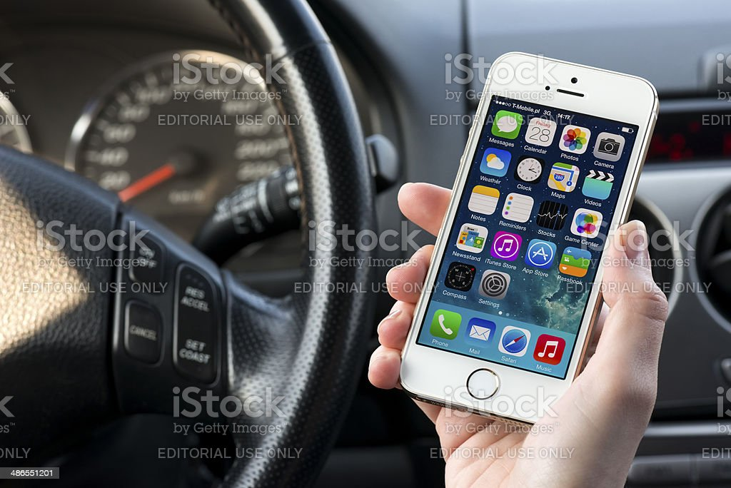 Using iPhone 5 in a car stock photo