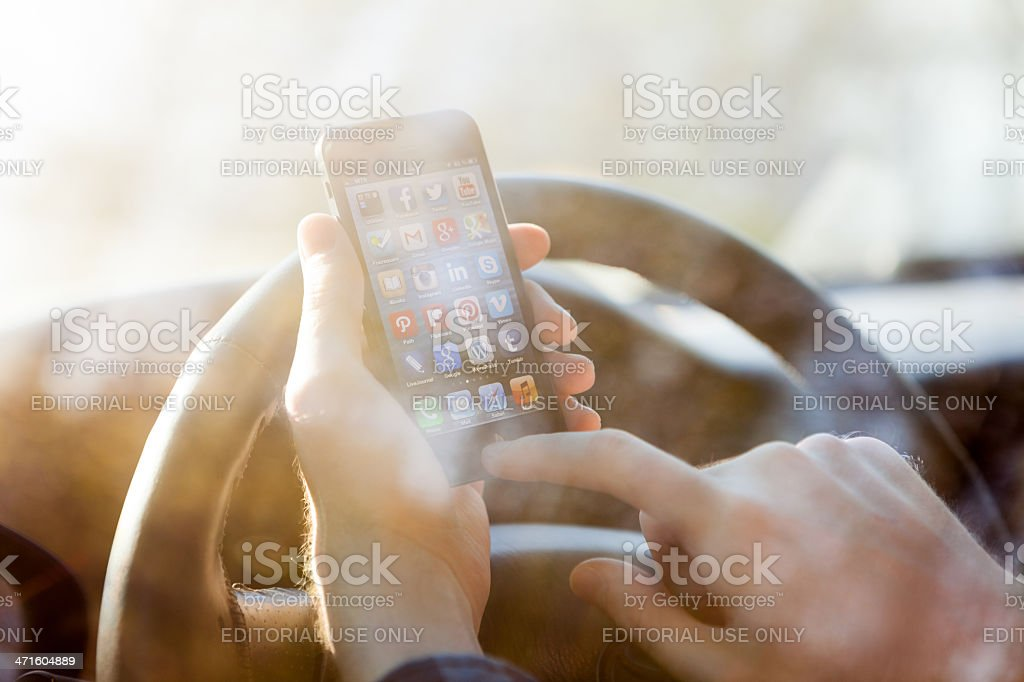 Using iPhone 5 in Car royalty-free stock photo