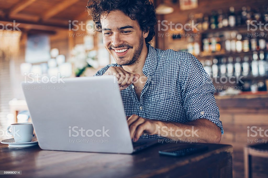 Using laptop in the cafe stock photo